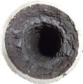 Usadený mangán vo vodovodnom potrubí